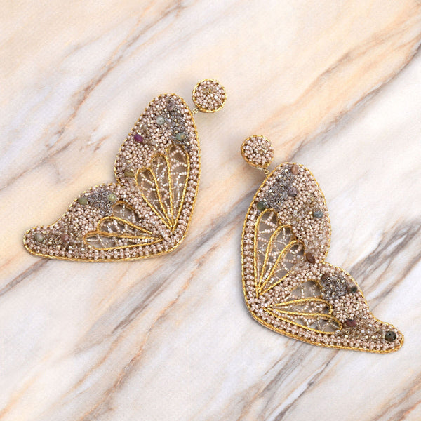 Deepa Gurnani Handmade Ellison Butterfly Earrings Gold on Slate Background