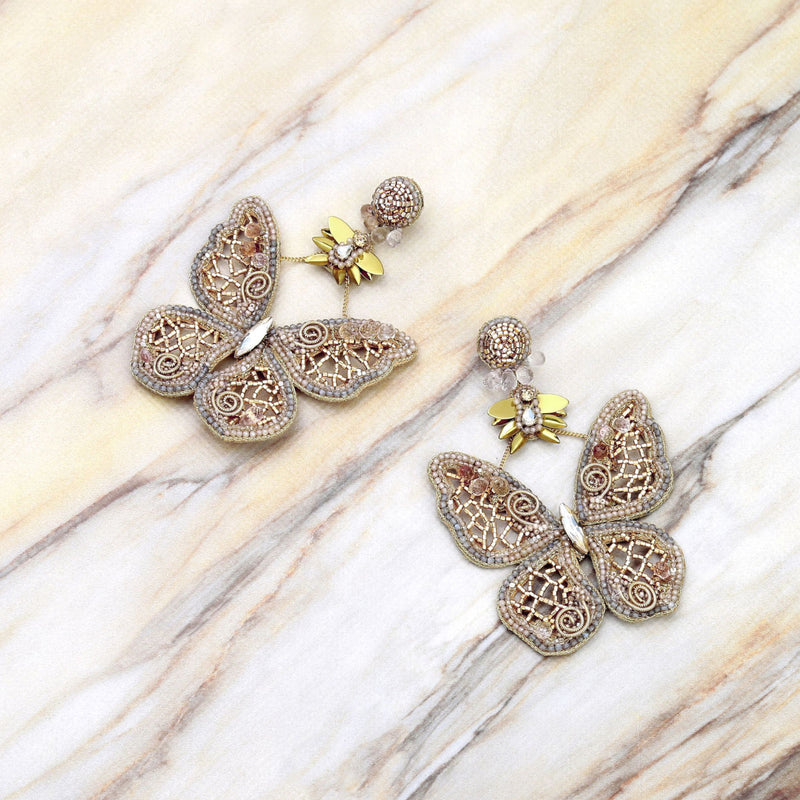 Deepa Gurnani Handmade Hayley Butterfly Earrings Gold on Slate Background