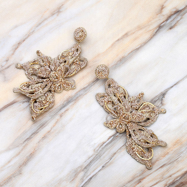 Deepa Gurnani Handmade Truly Earrings Gold on Slate Background