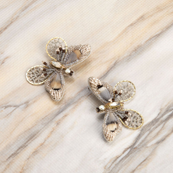 Deepa Gurnani Handmade Cate Butterfly Earrings Gold on Slate Background