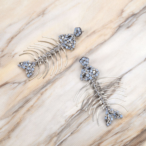 Deepa Gurnani Handmade Fishbone Earrings on Slate Background