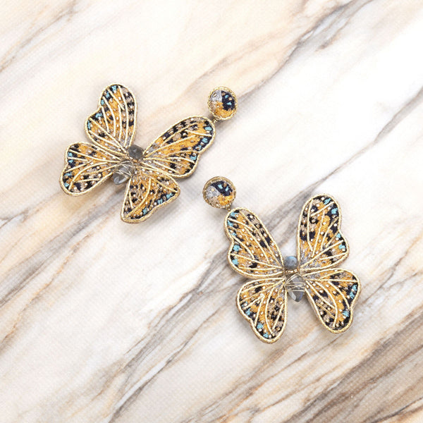 Deepa Gurnani Handmade Butterfly Earrings on Slate Background