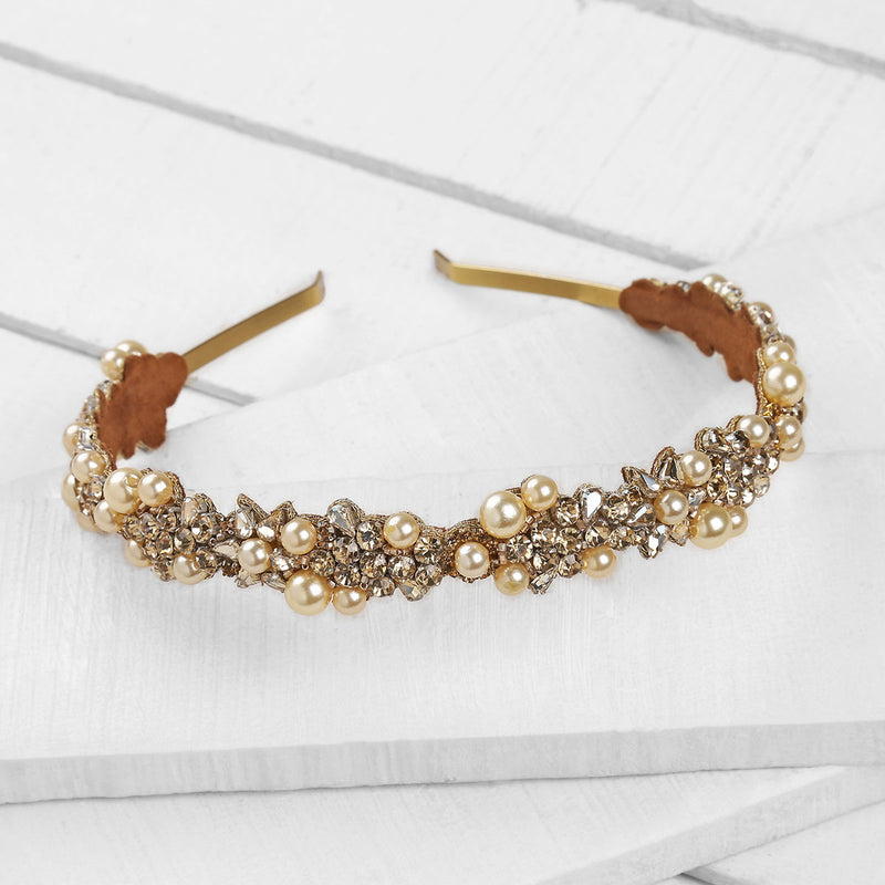 Deepa by Deepa Gurnani Handmade Peony Headband in Gold on Wood Background