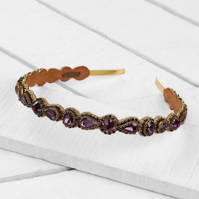 Deepa by Deepa Gurnani Handmade Coraline Headband in Purple on Wood Background