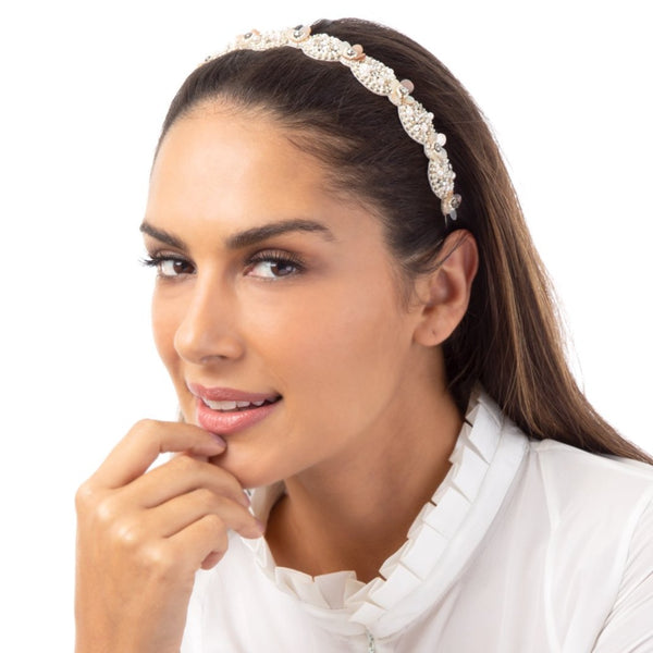 The hand embroidered Savanna Headband is sure to become the highlight of any look.