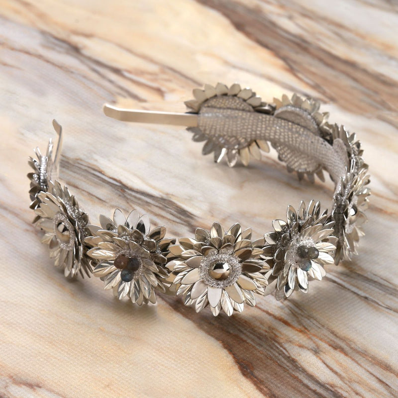 Deepa Gurnani Handmade Stormi Hard Headband Silver on Marble Background
