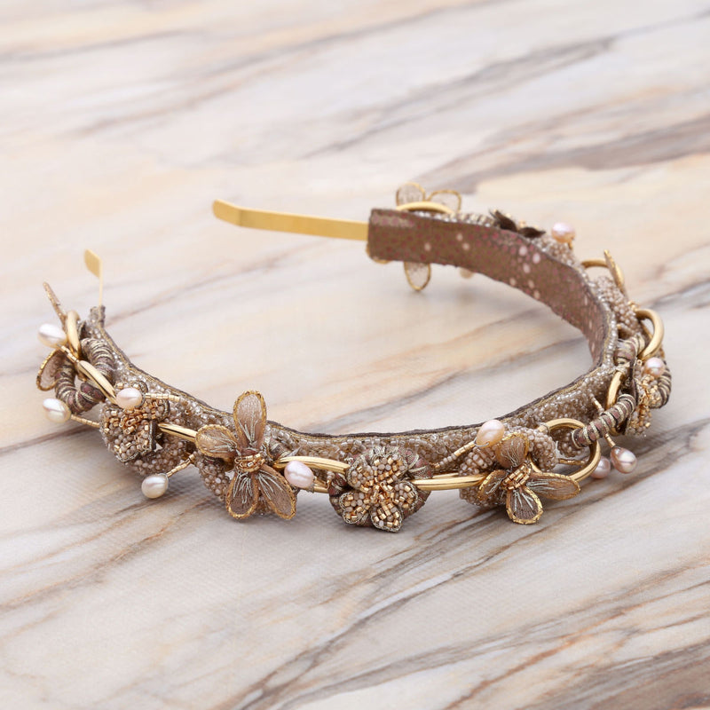 Deepa Gurnani Handmade Rayne Hard Headband Gold on Slate Background