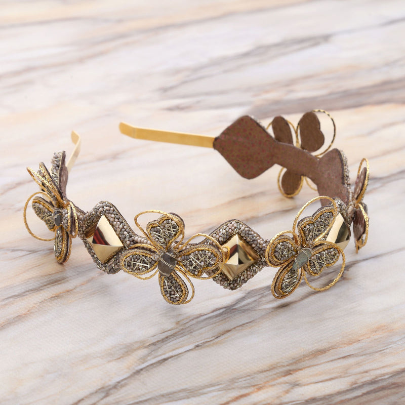 Deepa Gurnani Handmade Shandra Hard Headband Gold on Slate Background