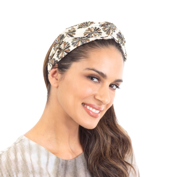 Our Hand Embroidered Nara Headwrap is the perfect go-to hair accessory.