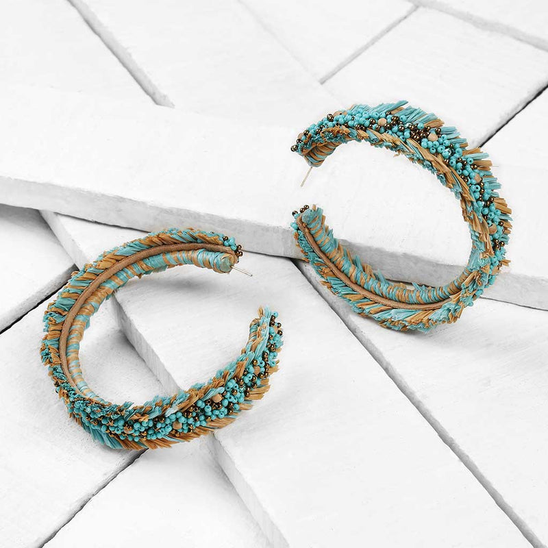 Deepa by Deepa Gurnani Handmade Emersyn Earrings in Turquoise on Wood Background