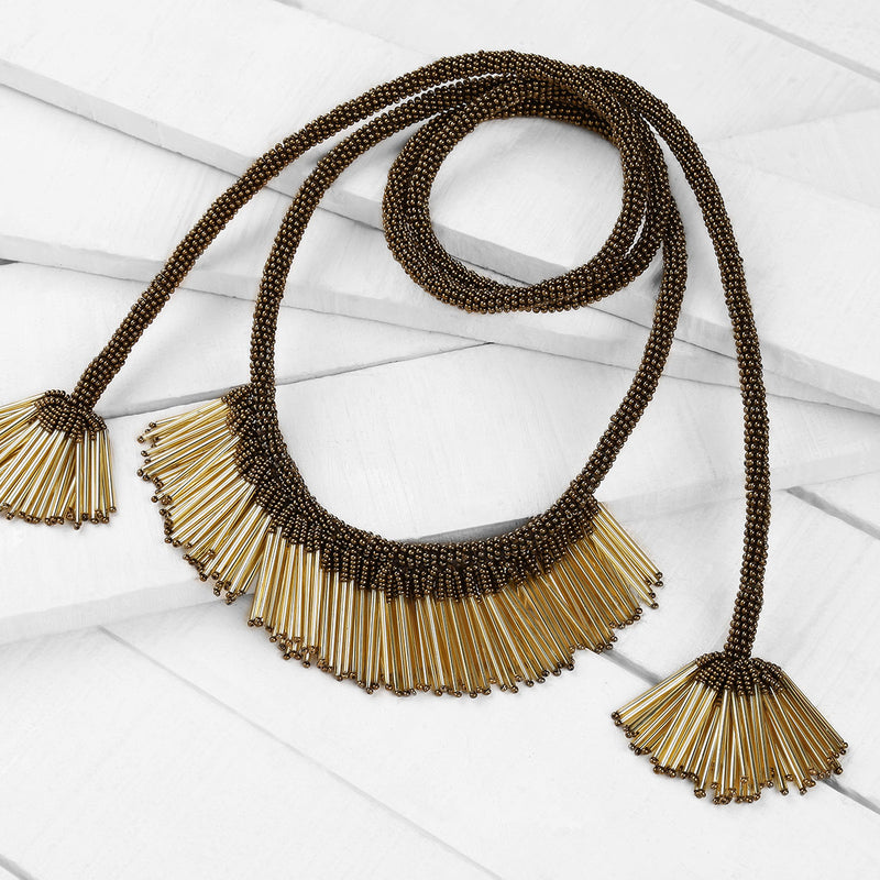 Deepa by Deepa Gurnani Handmade Mikaela Necklace in Gold on Wood Background