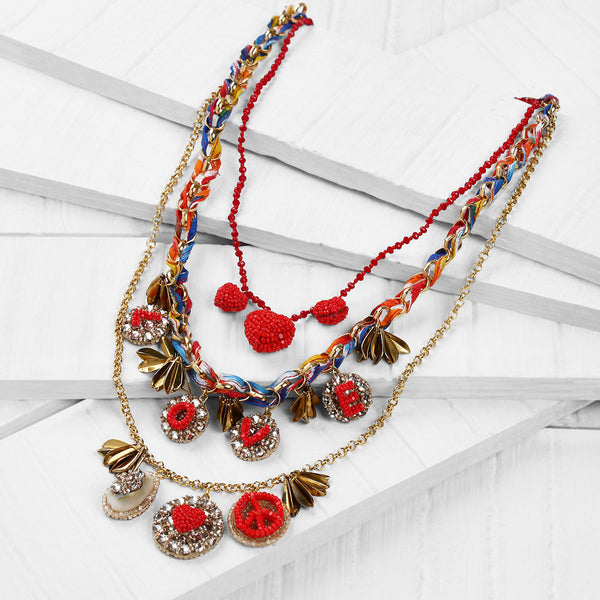 Deepa Gurnani Handmade Charley Necklace in Gold on Wood Background