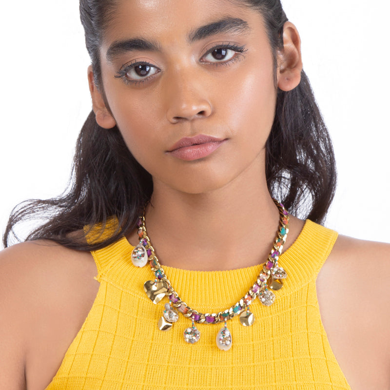 model wearing handmade gold brass necklace