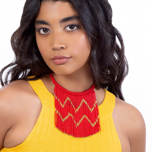 model wearing handmade red beaded necklace