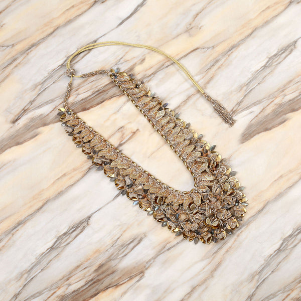 Deepa Gurnani Handmade May Necklace Gold on Slate Background