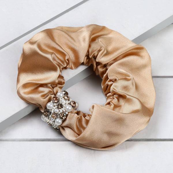 Deepa by Deepa Gurnani Patsy Scrunchie Champagne on Wood Background