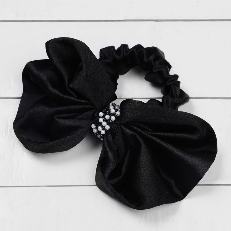 Deepa by Deepa Gurnani Nolita Bow Scrunchie Black on Wood Background