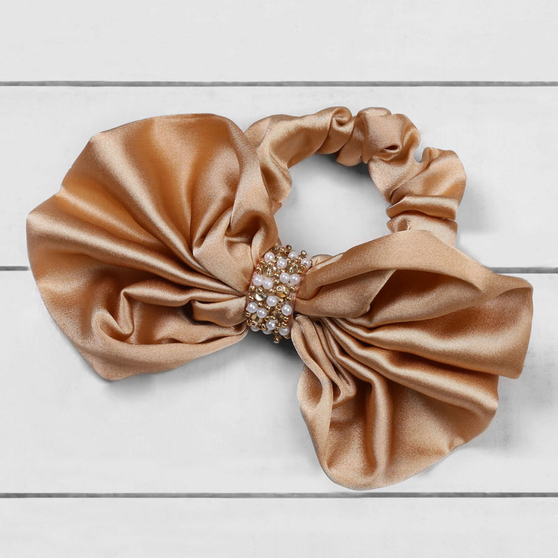 Deepa by Deepa Gurnani Nolita Bow Scrunchie Champagne on Wood Background