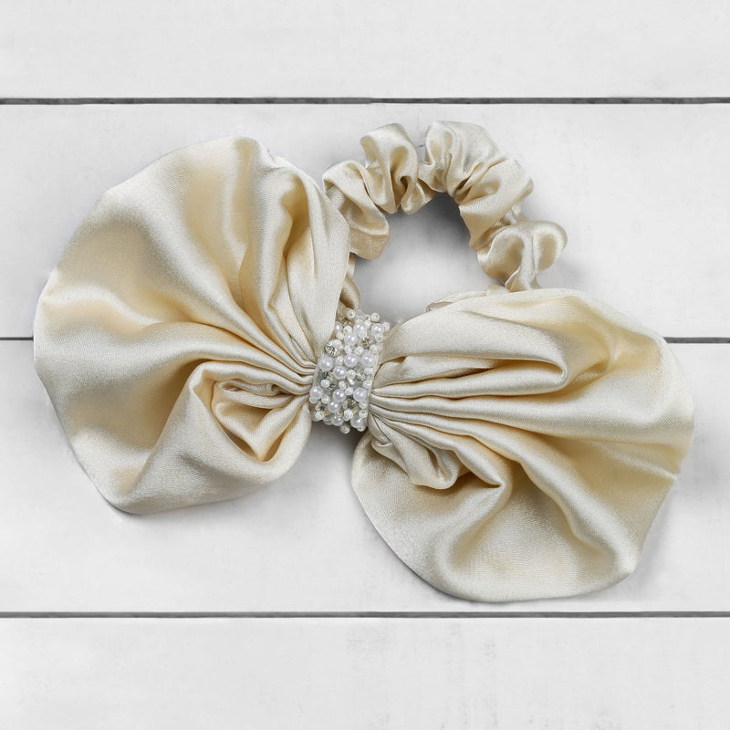 Deepa by Deepa Gurnani Nolita Bow Scrunchie Gold on Wood Background
