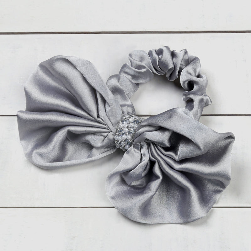 Deepa by Deepa Gurnani Nolita Bow Scrunchie Grey on Wood Background