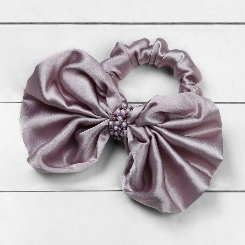 Deepa by Deepa Gurnani Nolita Bow Scrunchie Lilac on Wood Background