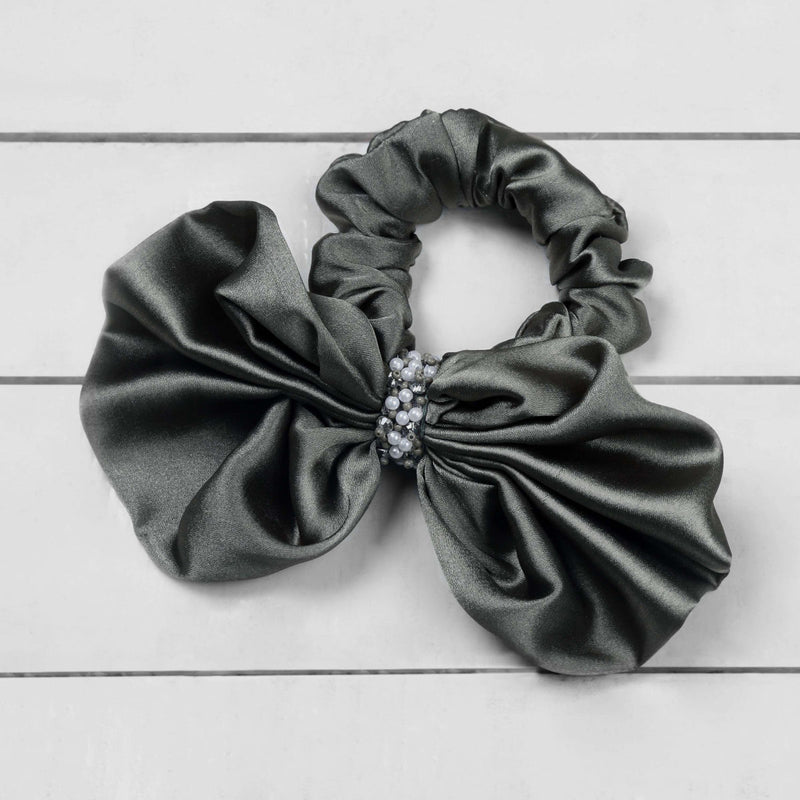Deepa by Deepa Gurnani Nolita Bow Scrunchie Olive on Wood Background