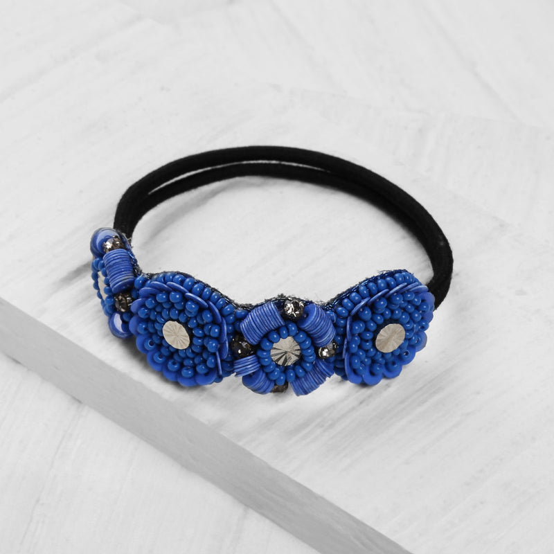 Deepa by Deepa Gurnani Christal Pony Denim Blue on Wood Background