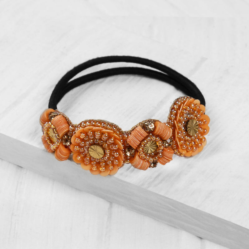 Deepa by Deepa Gurnani Christal Pony Dusty Orange on Wood Background