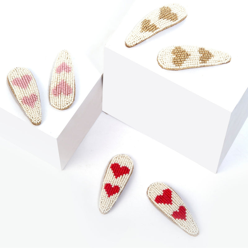 Hand embroidered hair clips with heart designs