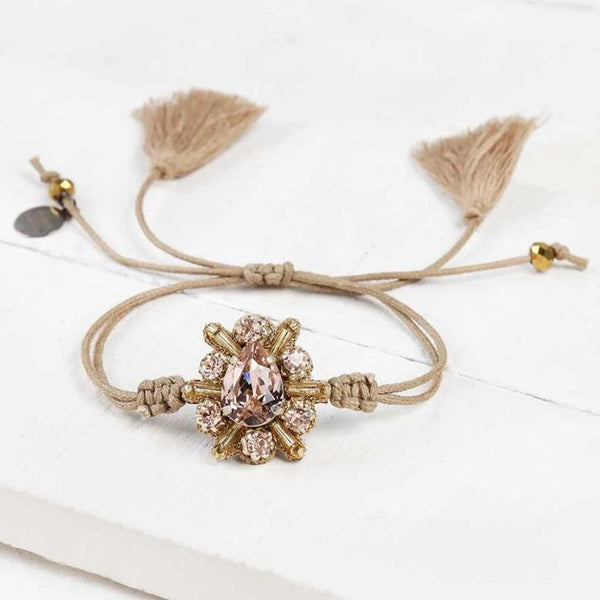 Deepa by Deepa Gurnani Estrella Cord Bracelet in Gold Color on Wood Background