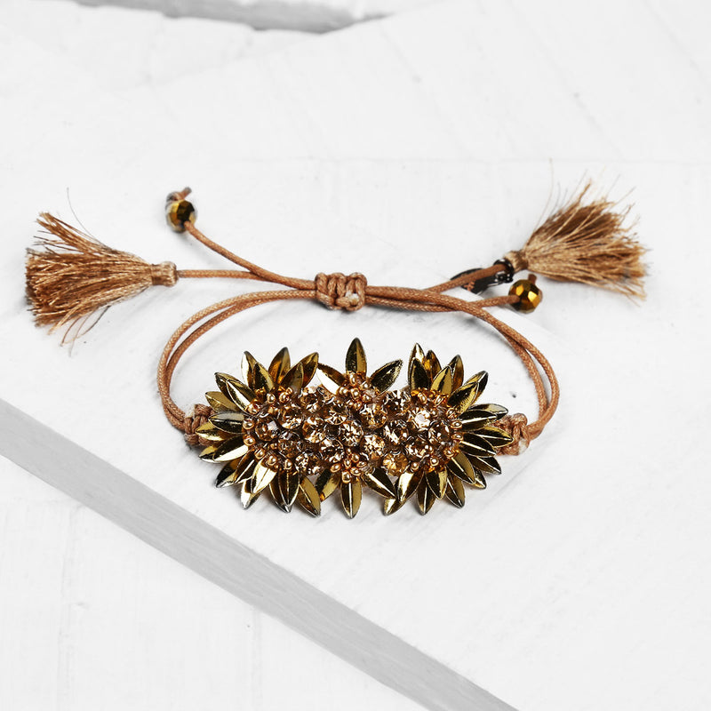 Deepa by Deepa Gurnani Handmade Zada Adjustable Cord Bracelet in Gold on Wood Background