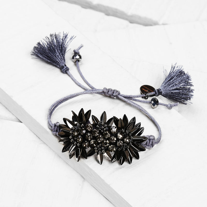 Deepa by Deepa Gurnani Handmade Zada Adjustable Cord Bracelet in Gunmetal on Wood Background