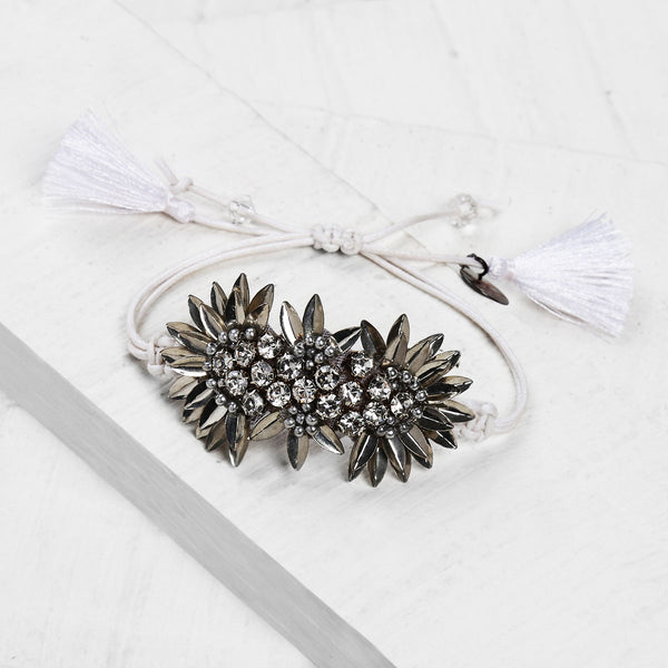 Deepa by Deepa Gurnani Handmade Zada Adjustable Cord Bracelet in Silver on Wood Background