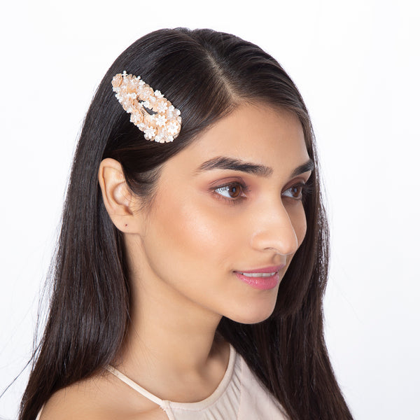 Model wearing handmade beaded flower pearl peach hair clip