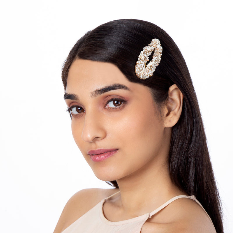 Model wearing handmade beaded gold hair clip
