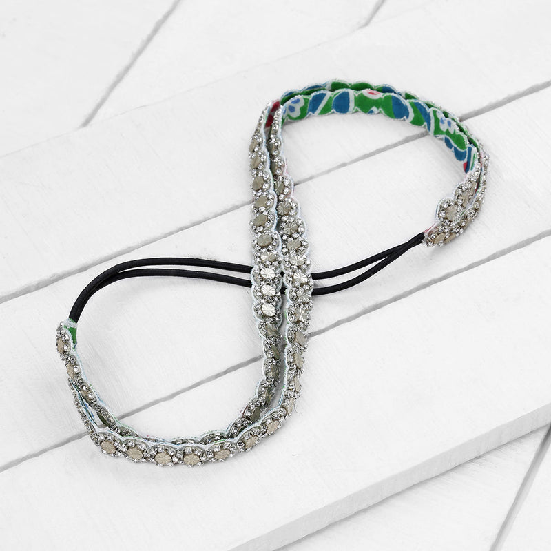 Deepa by Deepa Gurnani Handmade Tillie Headband in Silver on Wood Background