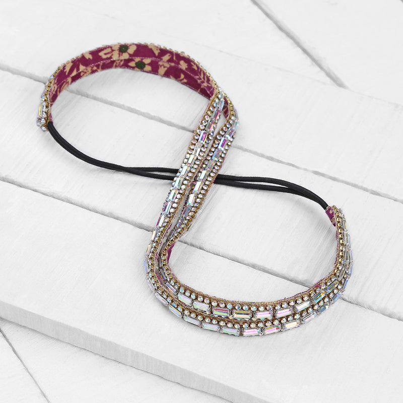 Deepa Gurnani Handmade Sydnee Headband in Iridescent on Wood Background