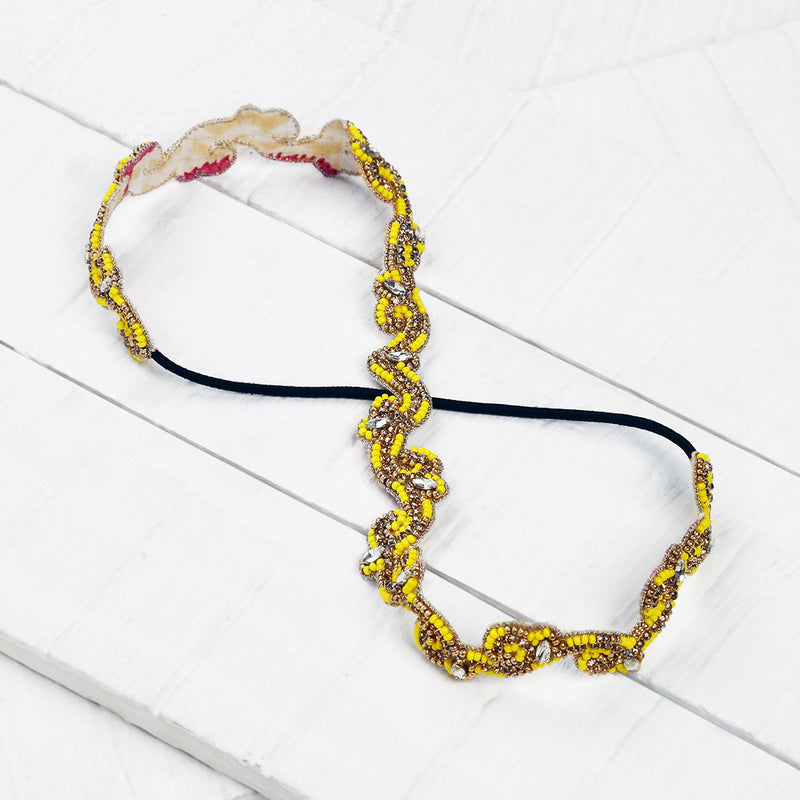 Deepa by Deepa Gurnani Handmade Ranya Headband in Yellow on Wood Background