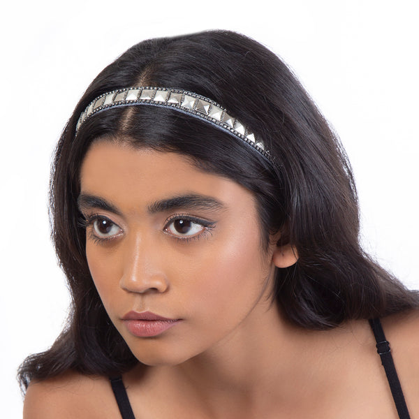 Model wearing silver embroidered headband