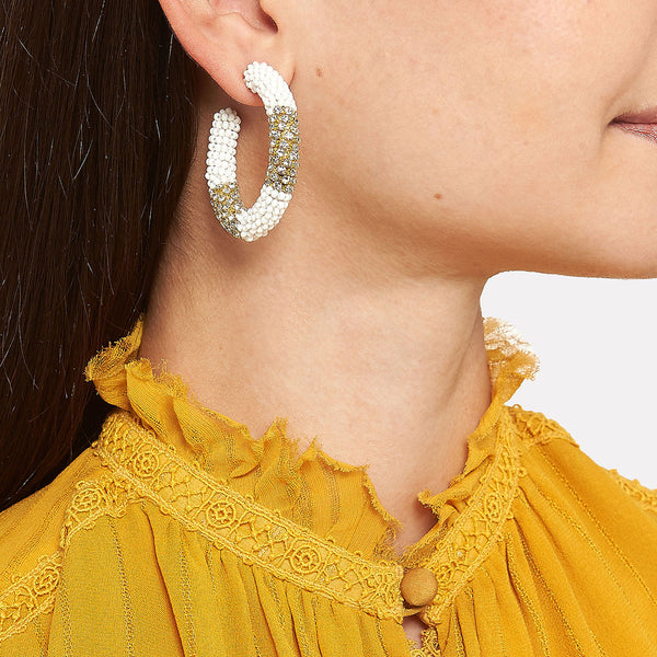 Gold and white hoop earrings
