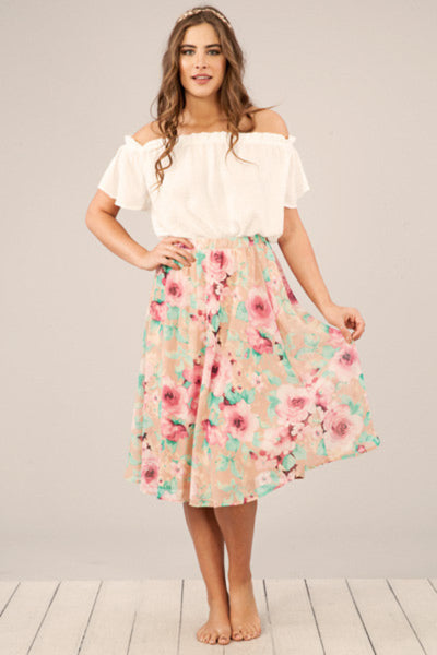 This floral skirt brings new meaning to style and grace! The floral print is truly unique! It's so wonderfully classy and feminine! The pleated waistline gives this beauty a fabulous amount of flare! This is the skirt you want for any spring wedding or shower! The Gypsy Catwalk Boutique Harrisonburg, Virginia Best Boutique Shopping JMU