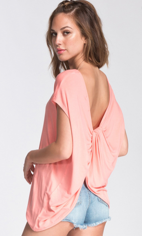 The Gypsy Catwalk You are going to be so perky about this top! It's so flow, coral color and the jersey knit material is breathable making it a perfect Summer top. The open twisted back is really what stands out about this top though! It's so cute!