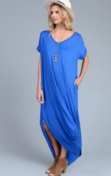The Gypsy Catwalk has this soft tee shirt maxi in stock. It has double slits, a v-neck and cuffed sleeves. Perfect and thin for summer. Available in Royal Blue and Dusty Pink.