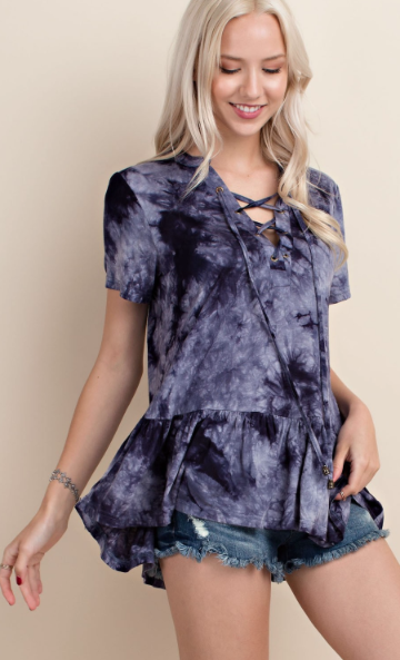 The Gypsy Catwalk is in the Shenandoah Valley. This adorable top features a trendy ruffled hemline. The navy lace up, tie-dye print can easily be paired with shorts in the Summer and skinny in the fall.