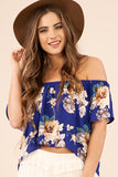 This top is a sure sign that spring is here! Just look at that gorgeous floral print! The off the shoulder neckline is pretty fab too! You are going to look amazing in this beauty! And! It has matching shorts or try it with these white shorts as pictured.