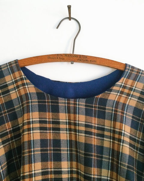 blue plaid cape.