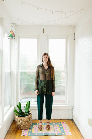 sheer green floral shirt.