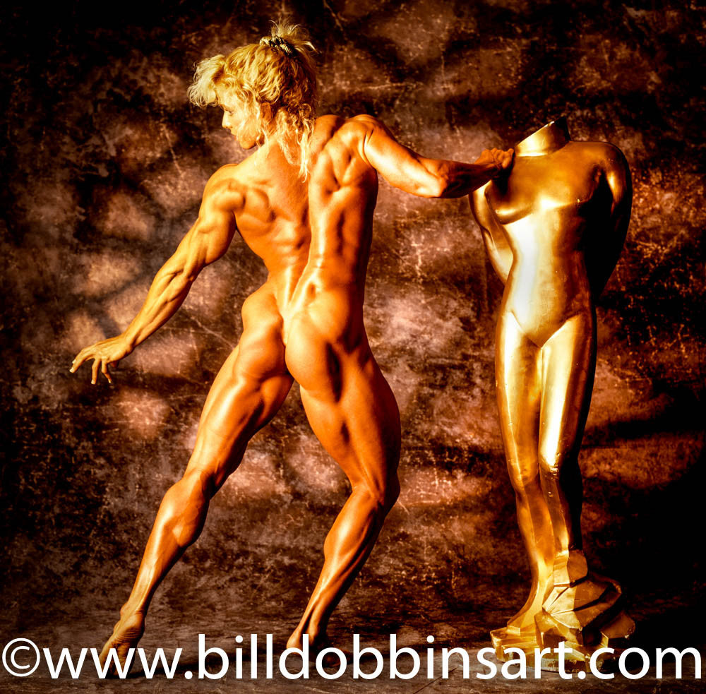 DEBBIE MUGGLI NUDE PRINT: Posing with gold statue