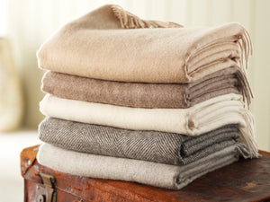 Pure wool blankets and pure wool throws in a variety of colours woven in the UK and presented by Urban Wool bedding.