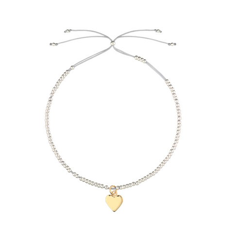 Estella Bartlett Heart Gold and Silver Plated Bracelet